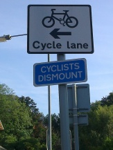 cyclists-dismount-stupid-sign