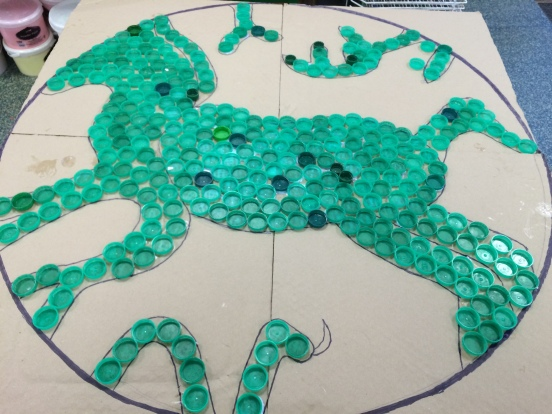Prae Wood logo made with bottle tops