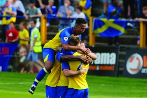 The Sainst Players celebrate Charlie Walkers winner