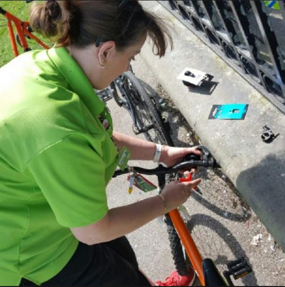 woman repair bike.png